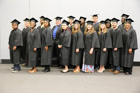Seventeen of the 21 adult basic education students in East Mississippi Community College's Adult Basic Education Launch Pad program who earned their high school equivalency diplomas participated in a graduation ceremony the night of Thursday, June 14.