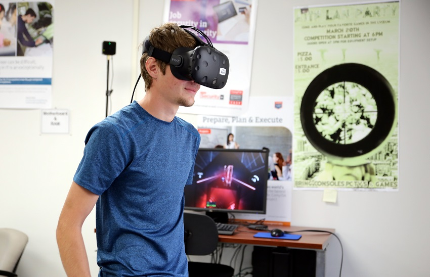 East Mississippi Community College Cyber Security student Karl Mast of Brooksville plays the virtual reality game Beat Saber, which will be among the many games available for play during the college's LAN party on Sept. 21.